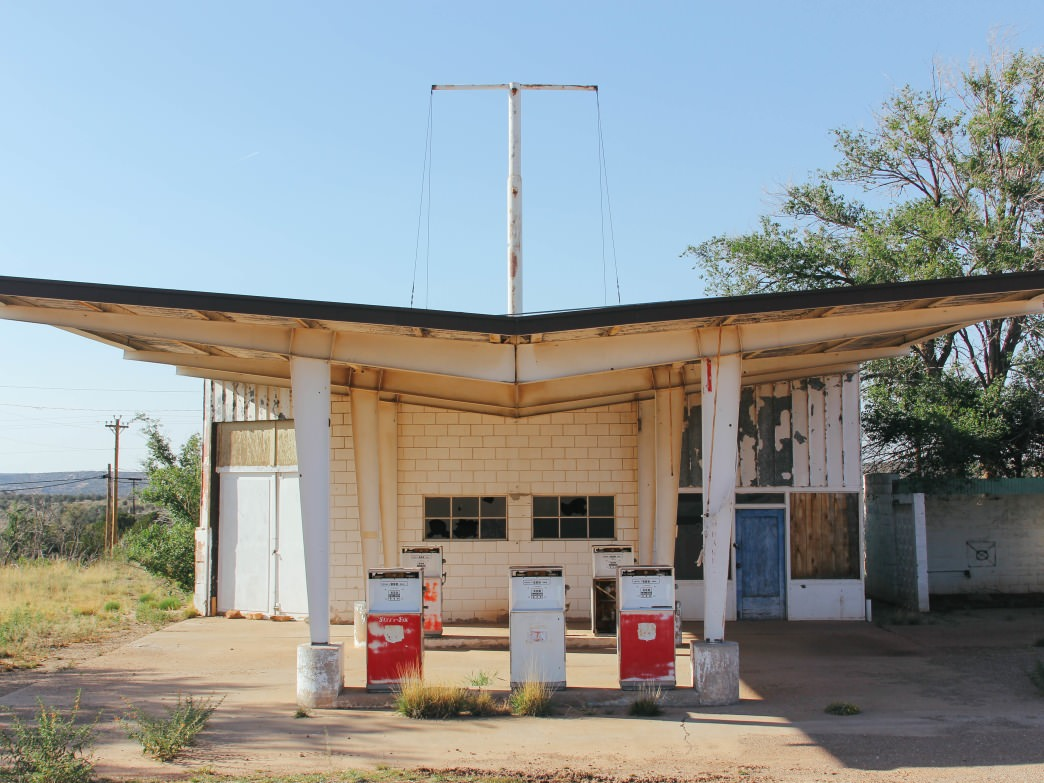 Abandoned buildings and gas stations dot the roadway from beginning to end.