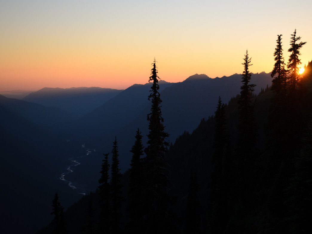 The sun sets over the Bailey Range in Olympic National Park