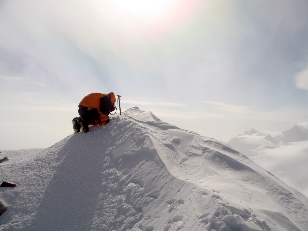 Reaching the peak of Vinson Massif in Antarctica.