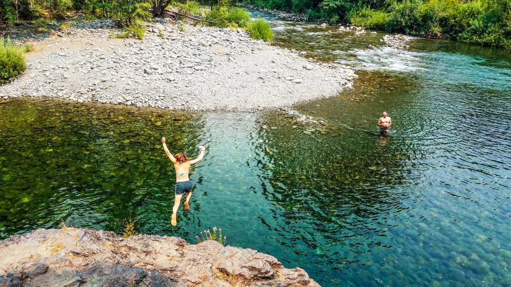 The crystal-clear, emerald waters of the Klamath River's tributaries provide endless swimming options during the region's endless summers. Peak-season temps in the low-100s make the chilly snowmelt streams perfect for relaxing on dog days.      Dylan Jones