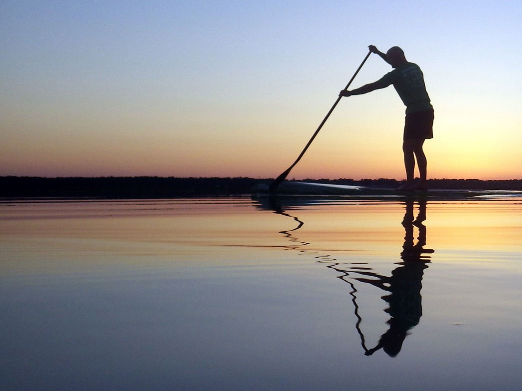 A paddleboarder in Bluffton at Sunset