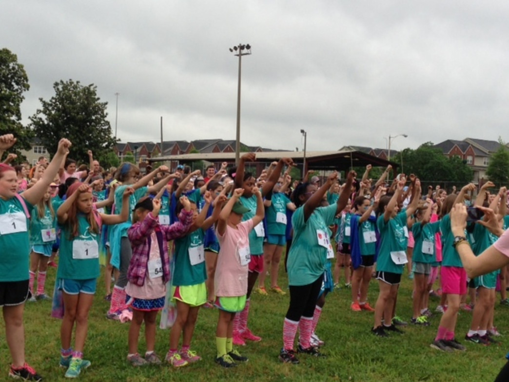 GOTR girls start each session with a warm up.