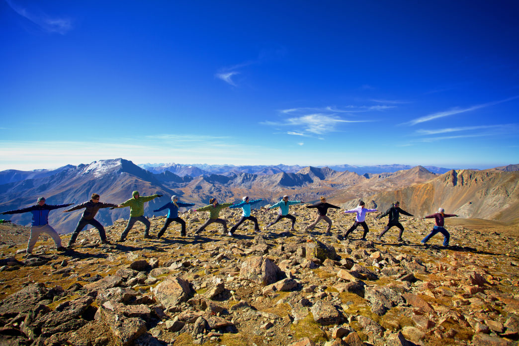 Getting outside for a workout in cooler temps is motivating. Try yoga atop a 14er, like these folks in CO.