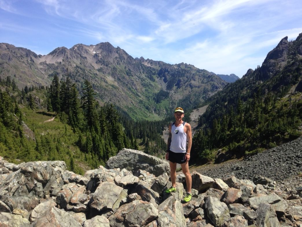 Ultra runner Korey Konga posing at Gladys Divide—one of his favorite trails in all of Olympic National Park