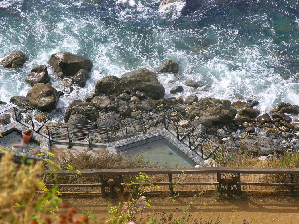 Esalen Hot Springs perches over the waves of the Pacific Ocean.