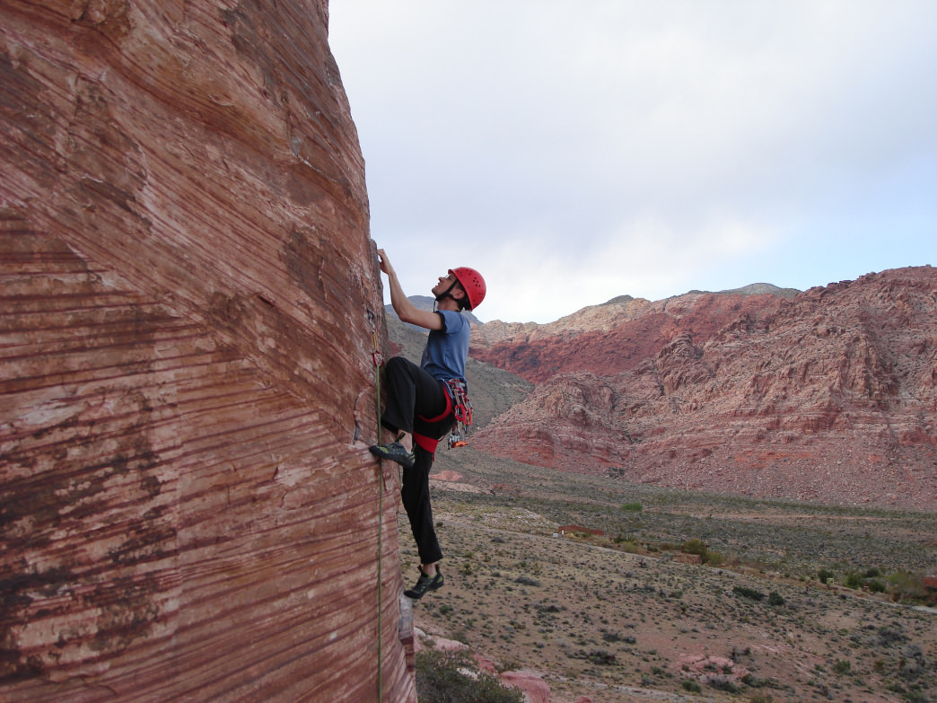 Climbing 'Caustic' (5.11b) at Cannibal Crag in Red Rock Canyon.