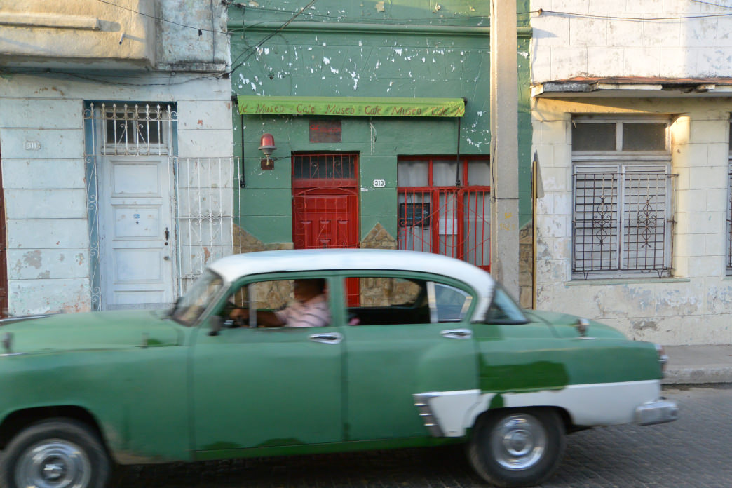 A quintessentially-Cuban vintage car awaits.