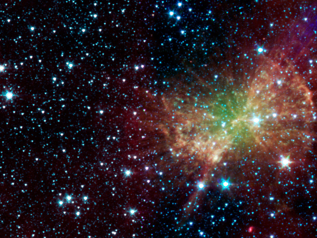 A nebula pours out infrared light from NASA's spitzer space telescope.