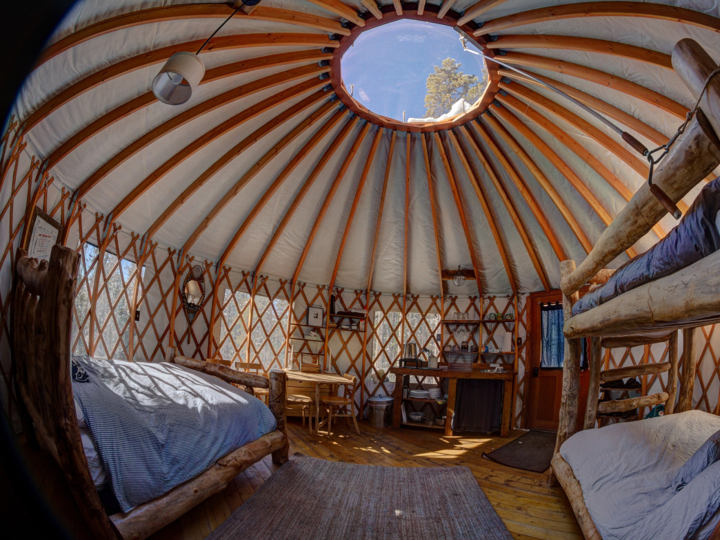 The inside of the Tennessee Pass Sleep Yurts is comfy and inviting