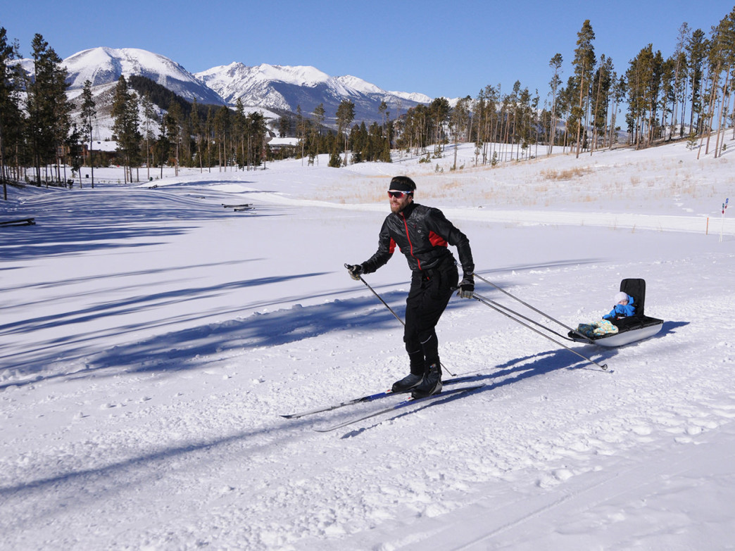 AJ Johnson pulls his six month old daughter Emma in a Pulk sled.