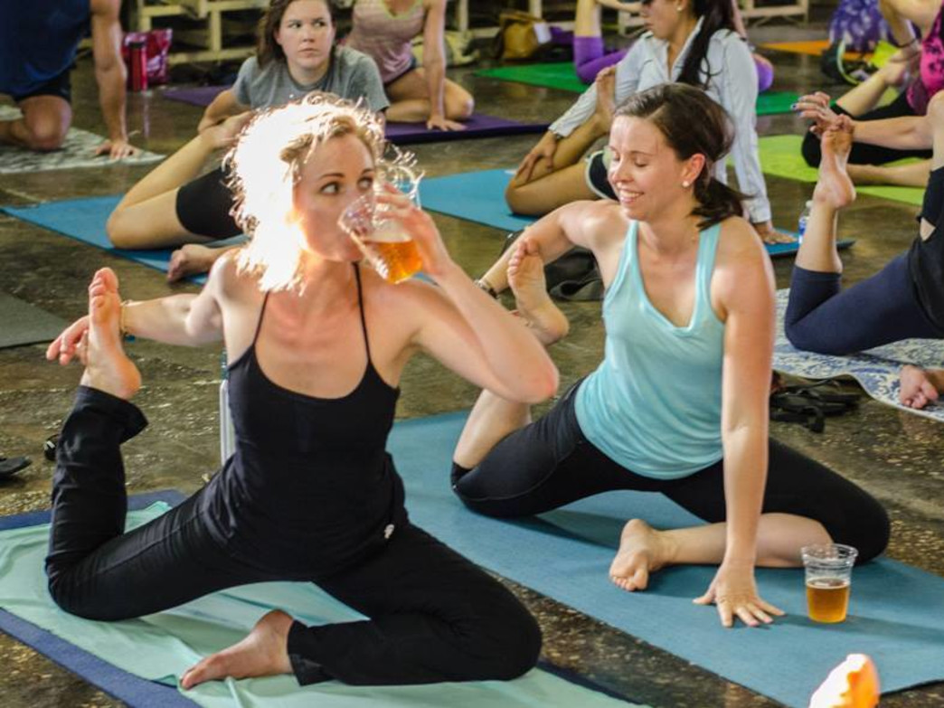 Combining yoga and beer can make both activities more fun.