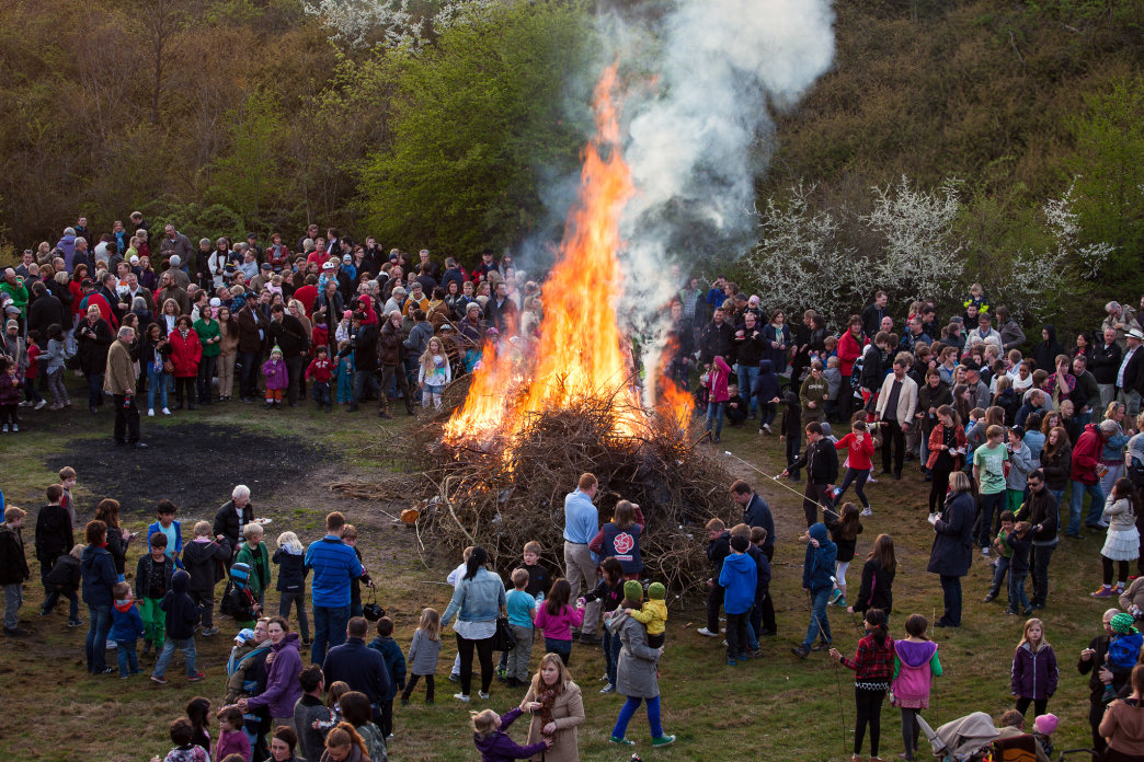 Spectators watch the huge bonfire as part of Walpurgis Night at Skansen in Stockholm.