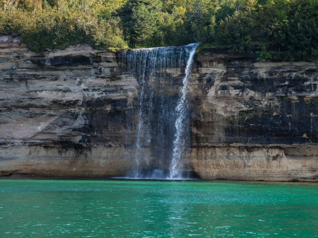 A waterfall tumbling into Lake Superior at Pictured Rocks National Lakeshore