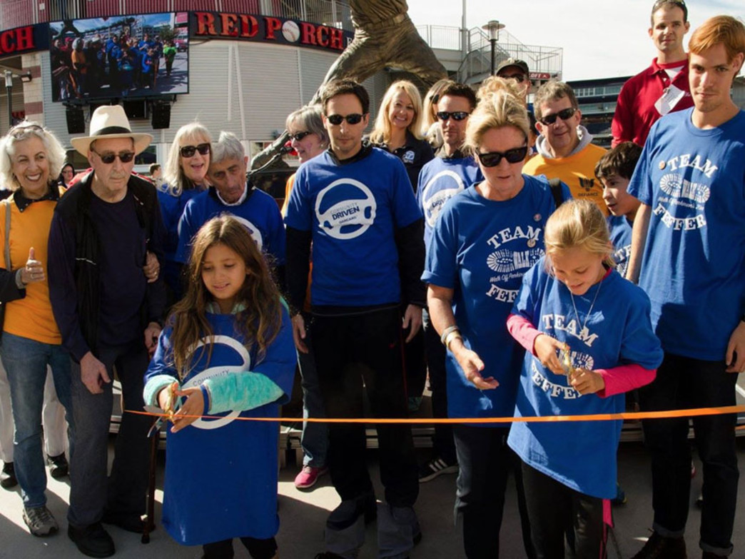 Participants in 2014's Walk off Parkinson's event cut  finish-line ribbon at National's Park.