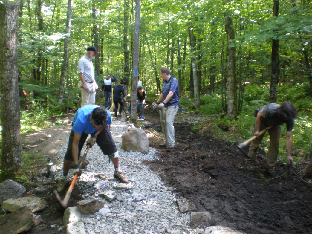 Upper Valley Trails Alliance works with crew of Gile Mountain in Norwich, VT.