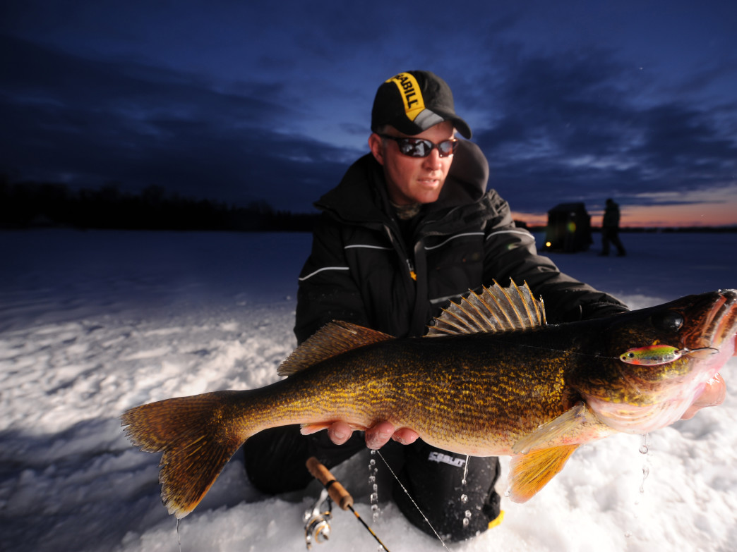 Dale Stroschein from Wacky Walleye Guide Service holds an ice fishing catch.