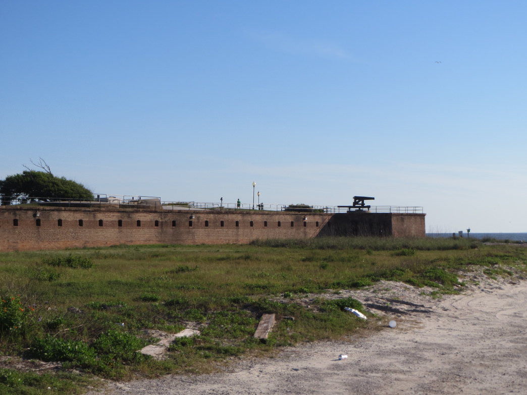 Walking along a beach of Dauphin Island, you'll come to the long quiet cannon and ramparts of Fort Gaines.     Joe Cuhaj